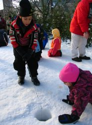 Kids trying ice fishing at Quebec Carnival